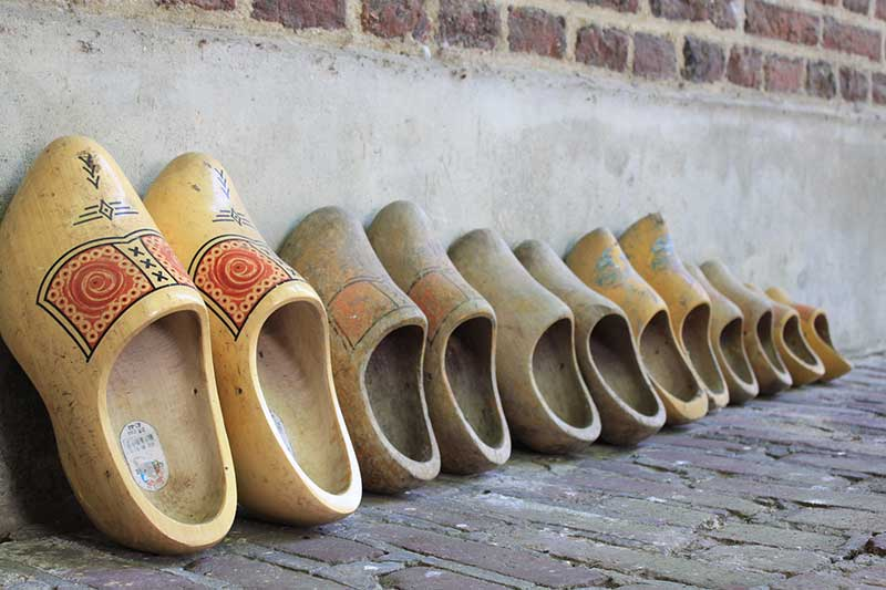 Collection of bridge money with a wooden shoe